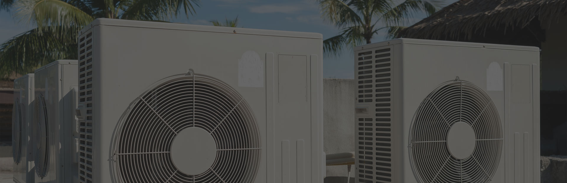two air conditioners with palms on a background